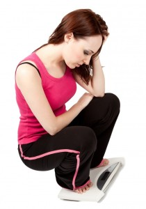weight-loss-scales-young-woman-worried-weight-diet