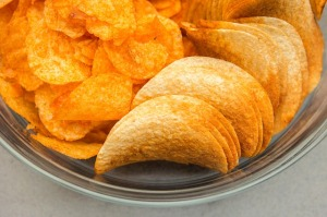 Barbecue flavored chips (crisps) confuse our brain. The intensive taste reminds our brain of well-seasoned meat, but there is barely any protein in it.